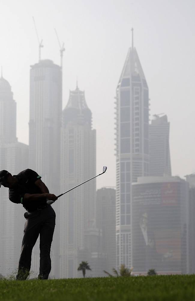 Tiger Woods from the U.S. plays a ball on the 13th hole during the second round of the Dubai Desert Classic golf tournament in Dubai, United Arab Emirates, Friday Jan. 31, 2014