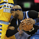 Dallas Mavericks shooting guard Vince Carter (25) collides with Denver Nuggets forward Wilson Chandler (21) in the third quarter of an NBA game in Denver on Wednesday, March 5, 2014. Denver won 115-110 The Associated Press