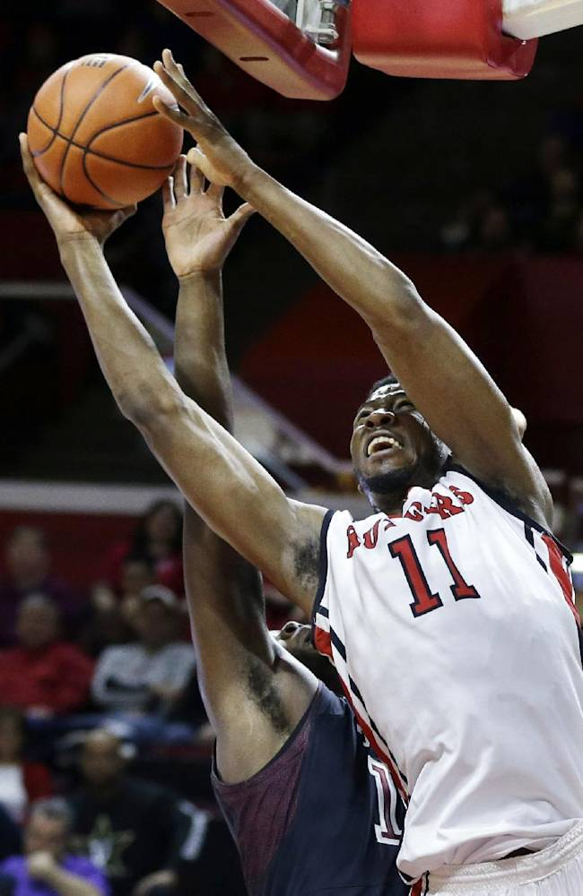Rutgers forward Kadeem Jack (11) takes a shot past Temple forward Mark Williams during the first half of an NCAA college basketball game in Piscataway, N.J., Wednesday, Jan. 1, 2014