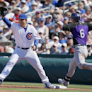 Chicago Cubs's Anthony Rizzo, left, stretches for the ball as he makes the catch just before runner Colorado Rockies's Corey Dickerson (6) reaches first base during the third inning of a spring training baseball game on Tuesday, March 11, 2014, in Mesa, A