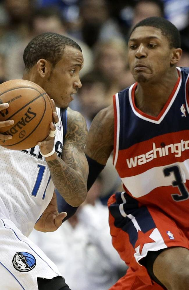 Dallas Mavericks' Monta Ellis (11) works on the perimeter as Washington Wizards' Bradley Beal (3) defends in the first half of an NBA basketball game, Tuesday, Nov. 12, 2013, in Dallas. Dallas won 105-95
