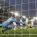 Tottenham Hotspur's Harry Kane, second right, scores their first goal of the game with a header during their English Premier League soccer match at the Liberty Stadium, Swansea, Sunday Dec. 14, 2014. (AP Photo / Nick Potts, PA)