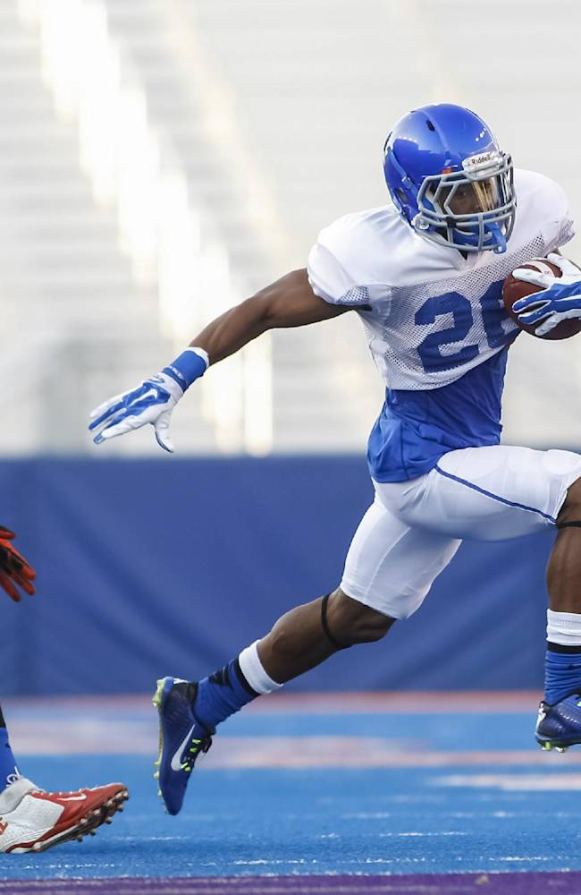 Boise State running back Devan Demas (26) carries the ball during the NCAA college football team's scrimmage in Boise, Idaho, on Friday, Aug. 15, 2014