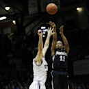 Providence guard Bryce Cotton, right, shoots over Butler guard Alex Barlow during the second half of an NCAA college basketball game in Indianapolis, Sunday, Feb. 23, 2014. Providence won 87-81 The Associated Press
