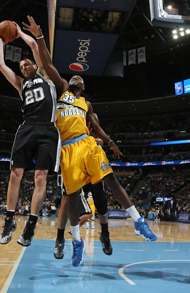 From left, San Antonio Spurs guard Manu Ginobili (20), of Argentina, pulls in a rebound in front of Denver Nuggets forwards Kenneth Faried and Boris Diaw, of France, in the first quarter of an NBA basketball game in Denver, Friday, March 28, 2014