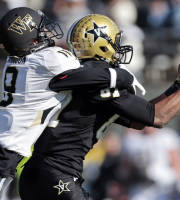 Vanderbilt wide receiver Jordan Matthews, right, catches a pass for a 41-yard gain as he is defended by Wake Forest cornerback Kevin Johnson, left, in the first quarter of an NCAA college football game on Saturday, Nov. 30, 2013, in Nashville, Tenn. (AP Photo/Mark Humphrey)