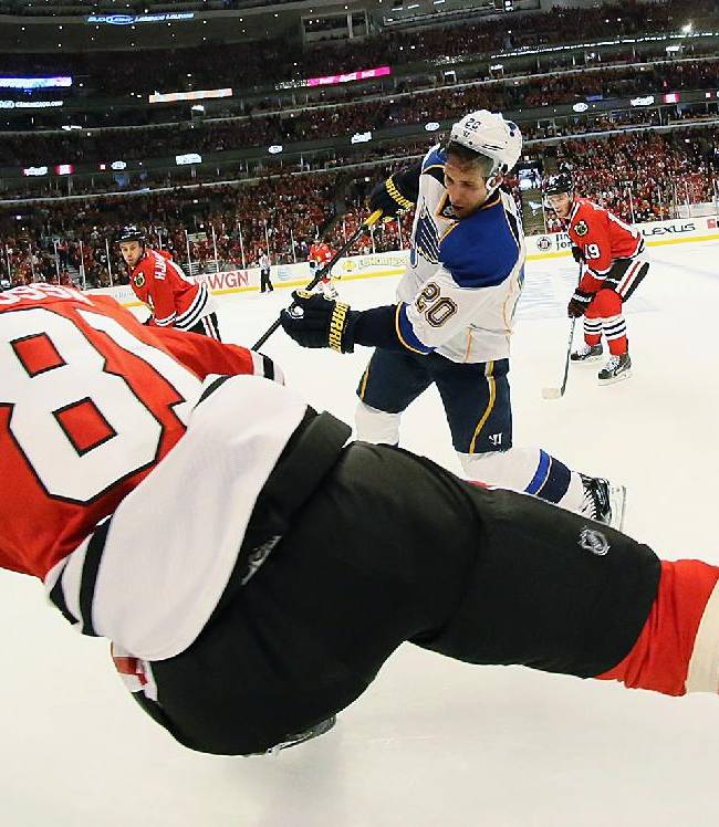 St. Louis Blues left wing Alexander Steen (20) tries to advance the puck against Chicago Blackhawks right wing Marian Hossa (81) in first period during Game 6 of a Western Conference quarterfinal playoff game, Sunday, April 27, 2014, at the United Center in Chicago