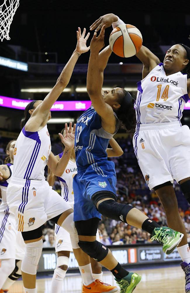 Phoenix Mercury's Alexis Hornbuckle (14) blocks the shot of Minnesota Lynx's Maya Moore, center, as Mercury's Candice Dupree, left, defends during the second half in a WNBA Western Conference Finals basketball game on Sunday, Sept. 29, 2013, in Phoenix. The Lynx defeated the Mercury 72-65 and woin the Western Conference Finals 2-0, earning a trip to the WNBA Finals to face the Atlanta Dream