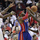 Detroit Pistons forward Josh Smith (6) loses control of the ball as he is pressured by Houston Rockets' Patrick Beverley, right, and Jordan Hamilton during the second half of an NBA basketball game, Saturday, March 1, 2014, in Houston. Houston won 118-110