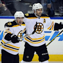 Boston Bruins' Brad Marchand (63) celebrates his NHL hockey game-winning goal with teammate Patrice Bergeron (37) during the overtime session against the Buffalo Sabres Thursday, Oct., 30, 2014, in Buffalo , N.Y. Boston won 3-2 The Associated Press
