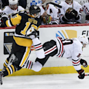 Pittsburgh Penguins' Brandon Sutter (16) collides with Chicago Blackhawks' Brandon Saad (20) during the third period of an NHL hockey game in Pittsburgh, Wednesday, Jan. 21, 2015. The Blackhawks won in a shootout, 3-2 The Associated Press
