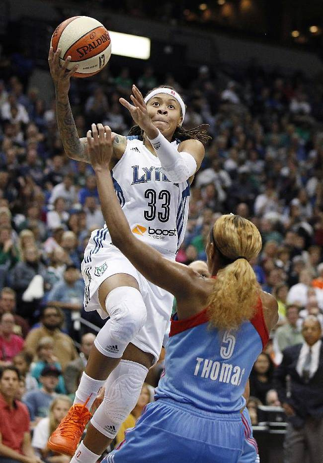 Minnesota Lynx guard Seimone Augustus (33) goes up for a shot against Atlanta Dream guard Jasmine Thomas (5) during the second half of Game 2 of the WNBA basketball finals, Tuesday, Oct. 8, 2013, in Minneapolis. Augustus scored 20 points as the Lynx won 88-63