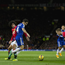 Chelsea's Cesc Fabregas, 4th left, fights for the ball against Manchester United players including Marouane Fellaini, third left, during the English Premier League soccer match between Manchester United and Chelsea at Old Trafford Stadium, Manchester, Eng