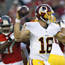 Washington Redskins quarterback Colt McCoy (16) avoids a rush by Tampa Bay Buccaneers defensive tackle Akeem Spence (97) during the first quarter of an NFL preseason football game Thursday, Aug. 28, 2014, in Tampa, Fla The Associated Press