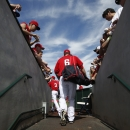 Los Angeles Angels' David Freese (6) walks out of the clubhouse prior to a spring training baseball game against the Chicago Cubs on Friday, Feb. 28, 2014, in Tempe, Ariz The Associated Press
