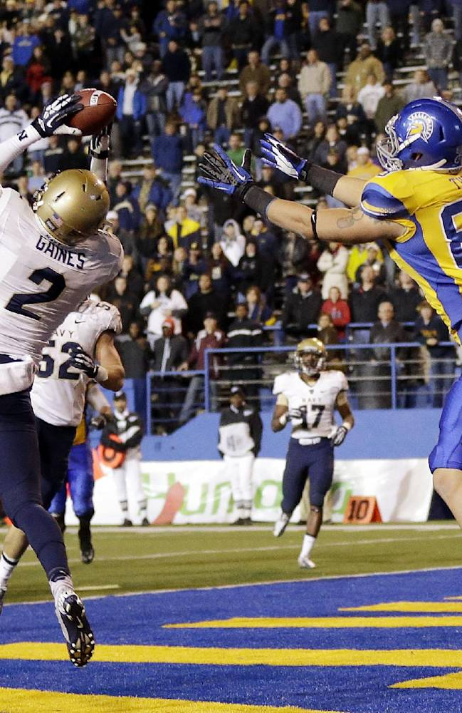 Navy cornerback Parrish Gaines intercepts a pass in the end zone intended for San Jose State tight end Jordan Thiel (83) during triple overtime of an NCAA college football game on Friday, Nov. 22, 2013, in San Jose, Calif.  Navy won 58-52 in triple overtime