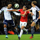 Manchester United's Radamel Falcao, center, is challenged by West Bromwich Albion's Joleon Lescott, left, and Craig Dawson during the English Premier League soccer match between West Bromwich Albion and Manchester United at the Hawthorns, Birmingham, Engl