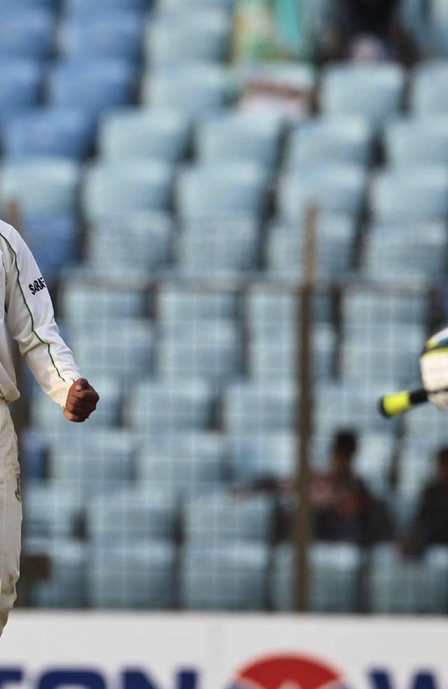Bangladesh's Abdur Razzak, left, reacts after taking the wicket of New Zealand's captain Brendon McCullum on the first day of their first test cricket match in Chittagong, Bangladesh, Wednesday, Oct. 9, 2013