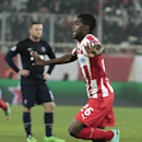 As Wayne Rooney looks on, Olympiakos' Joel Campbell celebrates after scoring the second goal of his team against Manchester United during their Champions League, round of 16, first leg soccer match at Georgios Karaiskakis stadium, in Piraeus port, near At