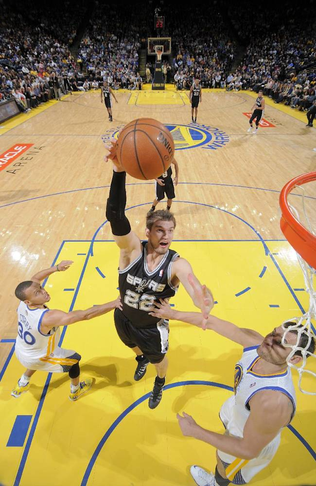 Short-handed Spurs outlast Warriors, 104-102