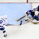 Tampa Bay Lightning center Tyler Johnson scores past St. Louis Blues goaltender Ryan Miller during the first period of an NHL hockey game, Tuesday, March 4, 2014 in St. Louis The Associated Press