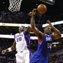 Phoenix Suns' Jermaine O'Neal (20) blocks the shot of Philadelphia 76ers' Lavoy Allen (50) during the first half of an NBA ba
