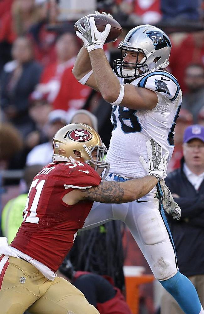 Carolina Panthers tight end Greg Olsen (88) catches a pass over San Francisco 49ers linebacker Dan Skuta (51) during the fourth quarter of an NFL football game in San Francisco, Sunday, Nov. 10, 2013