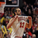 CHICAGO, IL - MARCH 09: Joakim Noah #13 of the Chicago Bulls pulls on his jersey in celebration at the end of a game against the Miami Heat at the United Center on March 9, 2014 in Chicago, Illinois. The Bulls defeated the Heat 95-88 in overtime. (Photo by Jonathan Daniel/Getty Images)