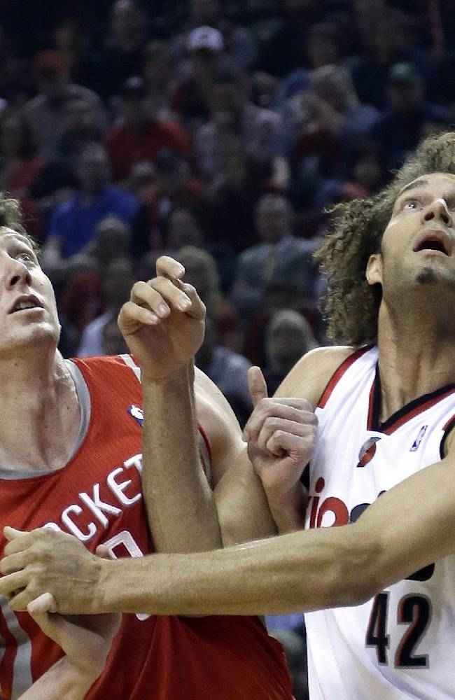 Houston Rockets center Omer Asik, left, and Portland Trail Blazers center Robin Lopez jockey for position on a free throw during the first half of Game 3 of an NBA basketball first-round playoff series in Portland, Ore., Friday, April 25, 2014