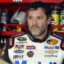 FILE - In this Sept. 13, 2014, file photo, Tony Stewart looks out from his garage during practice for the NASCAR Sprint Cup series auto race at Chicagoland Speedway in Joliet, Ill. A grand jury decided against charging Stewart in the death of Kevin Ward Jr. on a dirt track last month in upstate New York. Stewart took three weeks off from racing after the crash. (AP Photo/Paul J. Bergstrom, File)