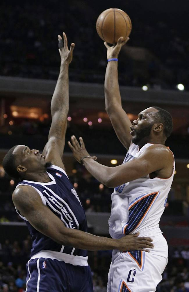 Charlotte Bobcats' Al Jefferson, right, shoots over Oklahoma City Thunder's Kendrick Perkins during the first half of an NBA basketball game in Charlotte, N.C., Friday, Dec. 27, 2013