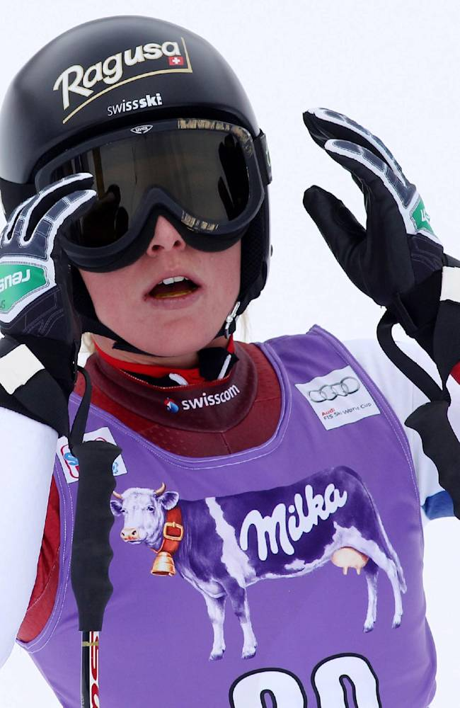 Switzerland's Lara Gut looks up at the finish area after placing fourth in an alpine ski World Cup women's downhill, in Cortina D'Ampezzo, Italy, Friday, Jan. 24, 2014