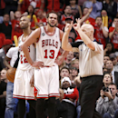 Chicago Bulls center Joakim Noah (13) looks at referee Joe Crawford after Crawford called a foul on Noah during the overtime period of Game 2 in an opening-round NBA basketball playoff series Tuesday, April 22, 2014, in Chicago. The Wizards won 101-99 The