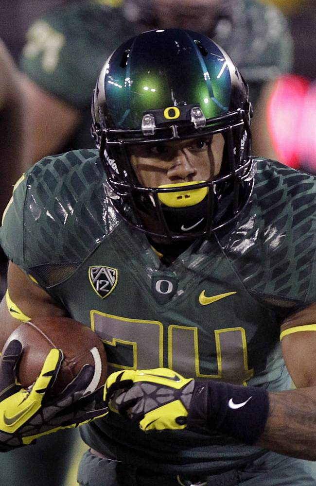 In this Oct. 26, 2013, file photo, Oregon running back Thomas Tyner carries the ball during the first half of an NCAA college football game against UCLA in Eugene, Ore. Tyner is ready to live up to the expectations that were heaped on him when he joined the Ducks. He was third on the Ducks with 711 yards rushing last year, and he scored nine touchdowns