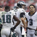 Philadelphia Eagles quarterback Nick Foles, center, meets with wide receiver Jeremy Maclin (18) and quarterback Mark Sanchez (3) on the sideline during the fourth quarter of an NFL football game against the San Francisco 49ers in Santa Clara, Calif., Sund