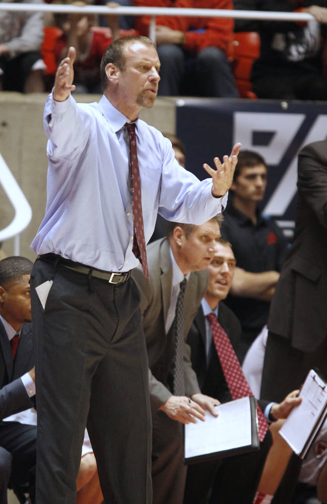Utah coach Larry Krystkowiak gestures to his players during the second half of an NCAA college basketball game against Oregon in Salt Lake City, Thursday, Jan. 2, 2014. Oregon beat Utah in overtime, 70-68