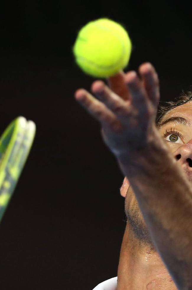 Richard Gasquet of France serves to Tommy Robredo of Spain during their third round match at the Australian Open tennis championship in Melbourne, Australia, Friday, Jan. 17, 2014