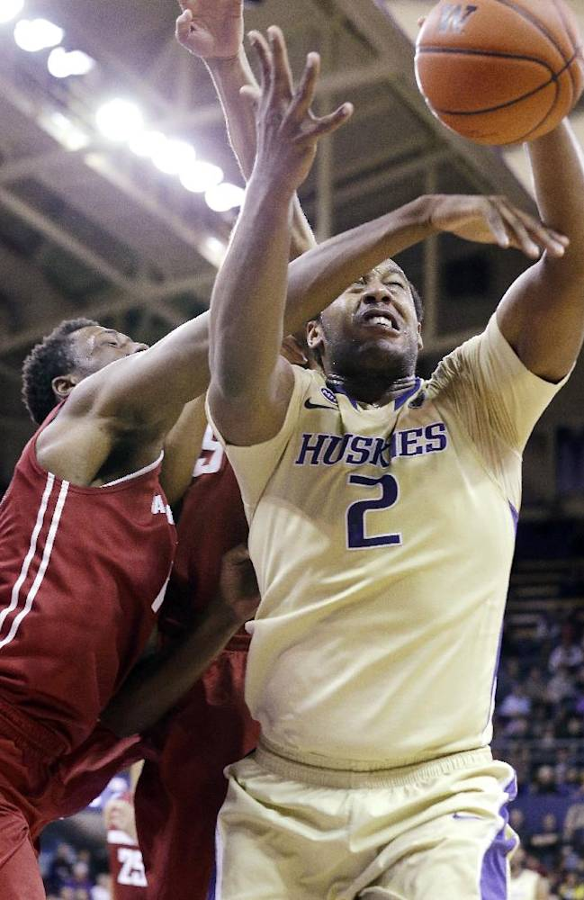 Washington's Perris Blackwell (2) reaches for a rebound against Washington State in the second half of an NCAA college basketball game Friday, Feb. 28, 2014, in Seattle. Washington won 72-49