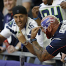 A New England Patriots fan, right, points toward a logo on his head next to Seattle Seahawks fans before the NFL Super Bowl XLIX football game Sunday, Feb. 1, 2015, in Glendale, Ariz The Associated Press