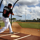 Miami Marlins' Casey McGehee takes batting practice during spring training baseball, Thursday, Feb. 20, 2014, in Jupiter, Fla The Associated Press