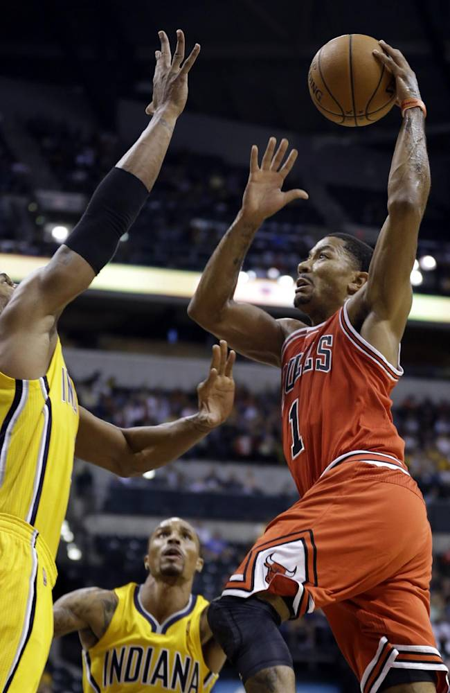 Chicago Bulls guard Derrick Rose, right, goes up for a shot over Indiana Pacers forward David West, left, in the first half of an NBA preseason basketball game in Indianapolis, Saturday, Oct. 5, 2013