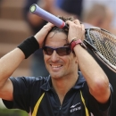 Spain's Tommy Robredo celebrates winning against compatriot Nicolas Almagro in their fourth round match at the French Open tennis tournament, at Roland Garros stadium in Paris, Sunday June 2, 2013. Robredo won in five sets 6-7, 3-6, 6-4, 6-4, 6-4. (AP Photo/Michel Euler)