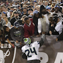 Seattle Seahawks running back Marshawn Lynch (24) greets fans during the second half of an NFL preseason football game against the Oakland Raiders in Oakland, Calif