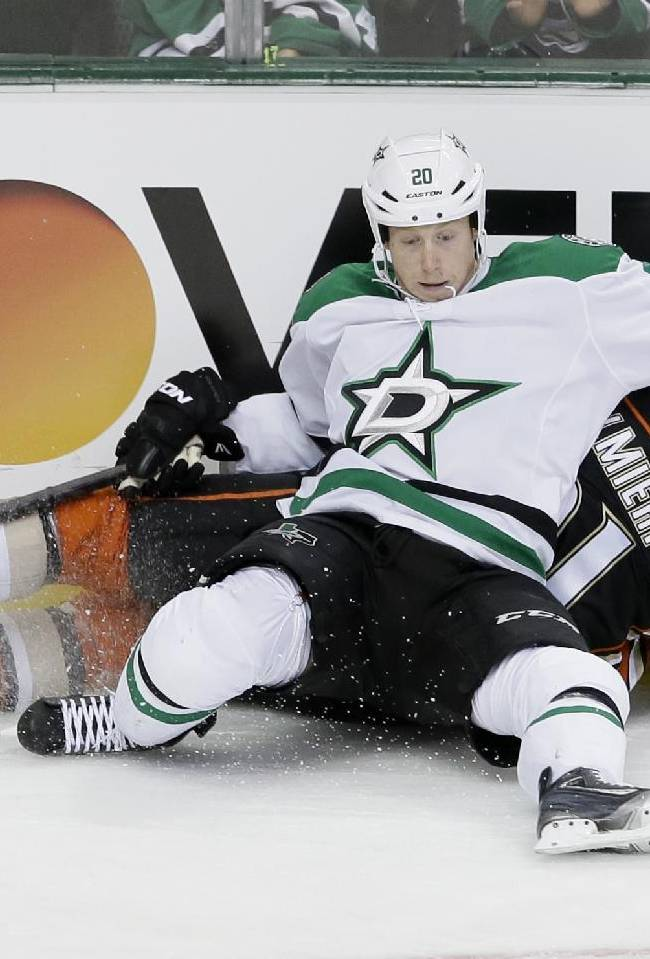 Dallas Stars center Cody Eakin (20) and Anaheim Ducks right wing Kyle Palmieri (21) slide into the boards during the second period of an NHL hockey game in Dallas, Tuesday, Nov. 26, 2013