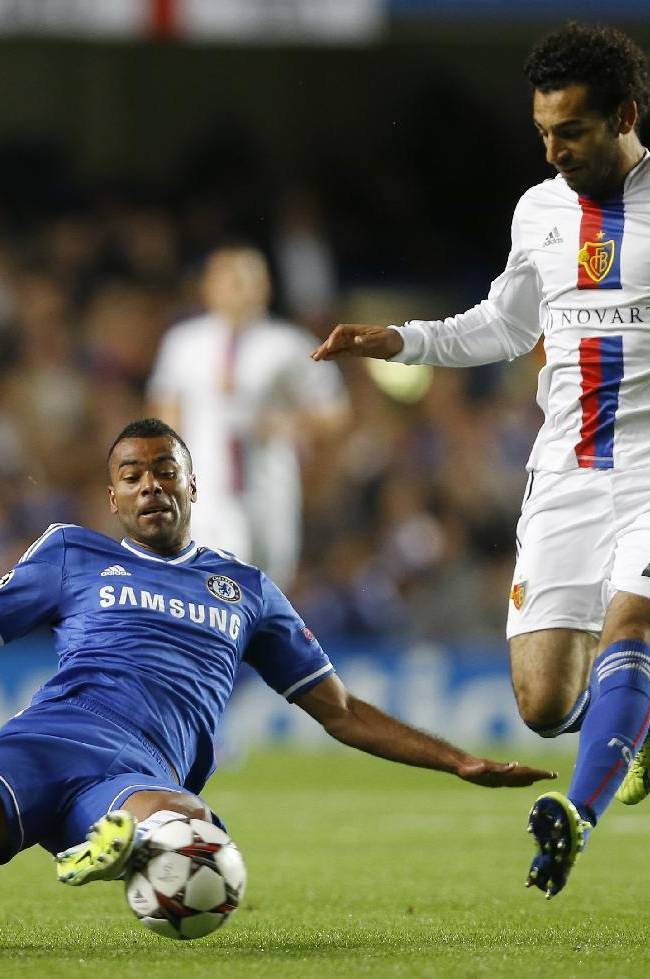 Chelsea's Ashley Cole, left, takes the ball from Basel's Mohamed Salah during the Champions League group E soccer match between Chelsea and Basel at Stamford Bridge stadium in London, Wednesday, Sept.  18,     2013