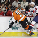 Philadelphia Flyers' Pierre-Edouard Bellemare (78) is tripped by Washington Capitals' Jason Chimera (25) during the third period of an NHL hockey game, Thursday, Jan. 8, 2015, in Philadelphia. Philadelphia won 3-2 in overtime The Associated Press