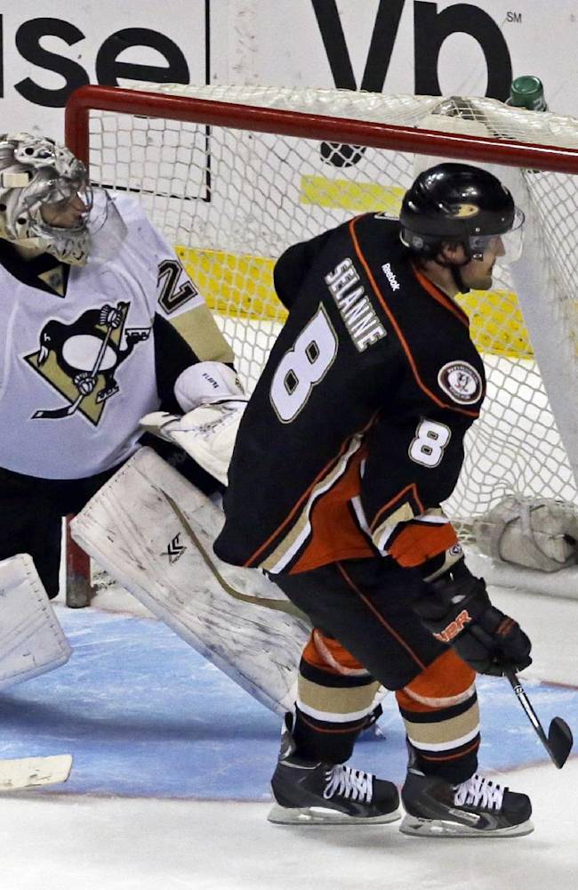 Anaheim Ducks right winger Teemu Selanne (8), of Finland, scores a goal against Pittsburgh Penguins goalie Marc-Andre Fleury (29) in a  shootout in an NHL hockey game in Anaheim, Calif., Friday, March 7, 2014.  The Penguins outlasted the Ducks in the shootout, 3-2