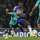 Chelsea's Ramires, back, challenges for the ball with Schalke's Sidney Sam during the Champions League group G soccer match between Chelsea and Schalke 04 at Stamford Bridge stadium in London, Wednesday, Sept. 17, 2014