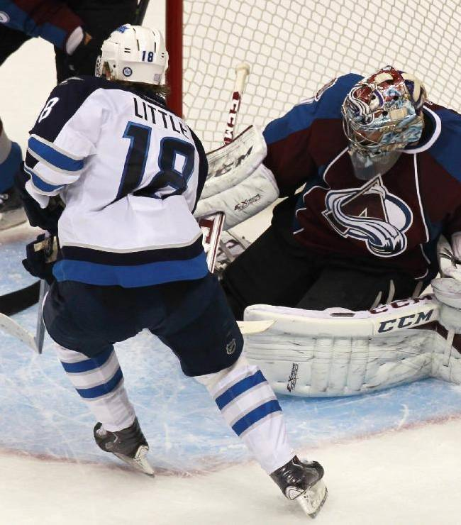 Colorado Avalanche goalie Semyon Varlamov, back, of Russia, deflects a shot off the stick of Winnipeg Jets center Bryan Little in the third period of the Avalanche's 3-2 victory in an NHL hockey game in Denver on Sunday, Oct. 27, 2013