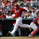 St. Louis Cardinals' Yadier Molina, center, scores off a single by teammate Mark Ellis in the second inning of an exhibition spring training baseball game against the Washington Nationals, Saturday, March 8, 2014, in Jupiter, Fla The Associated Press